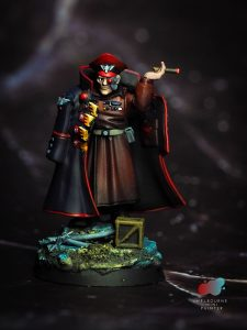 Photo of Astra militarum commissar painted by melbourne mini painter smoking a cigar